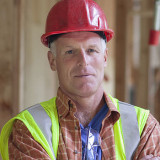 Portrait of serious construction worker